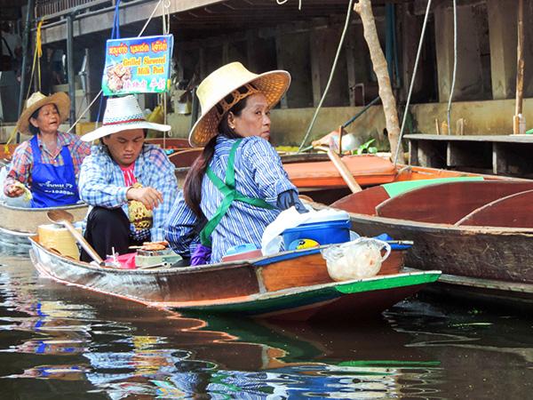 women in sampans outside Bangkok