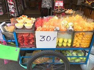 A sidewalk fruit cart in Bangkok