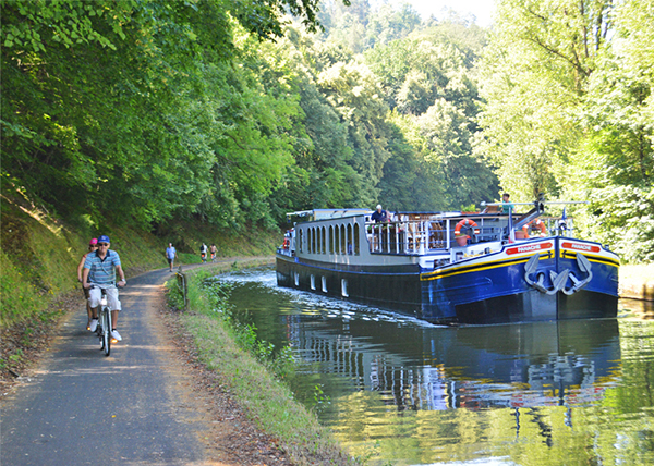 people bicycling along a canal while Barging in Europe