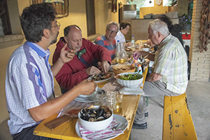 people eating sefood in in Friuli Venezia Giulia