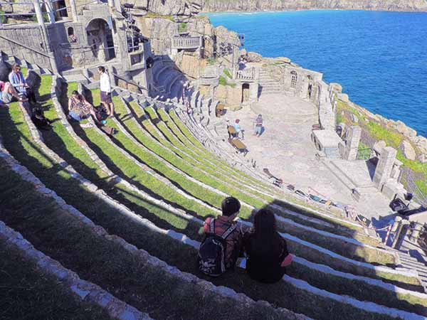 people in a greek theater in Cornwall
