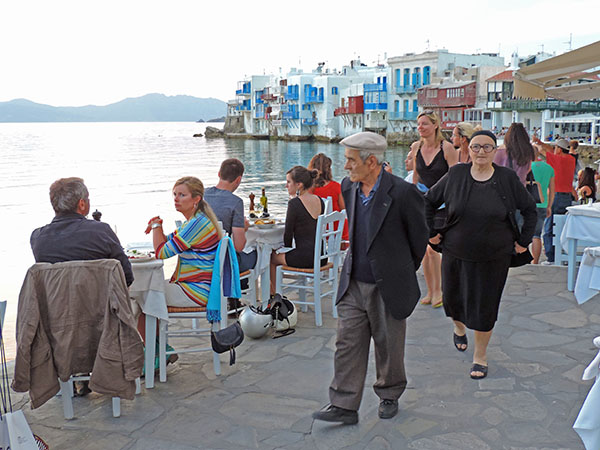 people walking by the water in the Greek islands