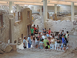 people in an archeological site in teh Greek islands