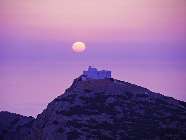a church on a hilltop in the Greek islands