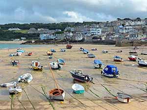 boats in a dry harbor in Cornwall