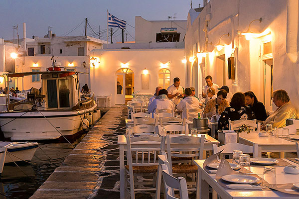 people at an outside restaurant in the Greek islands