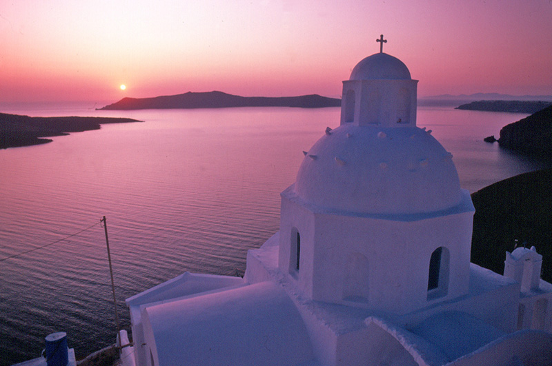 a church at sunset in the Greek islands