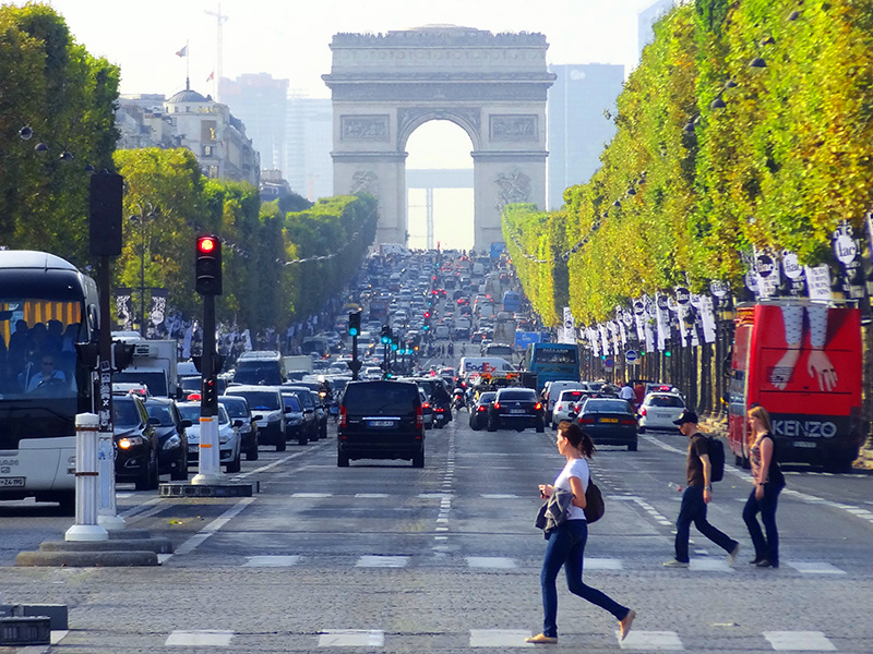 women crossing a street - places to visit in Paris