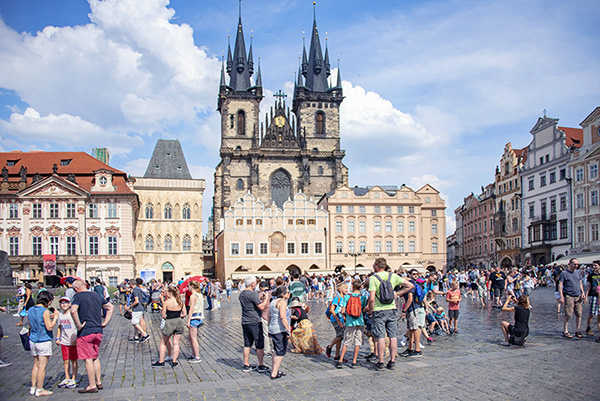 a large square wurrounded by old buildings - things to do in Prague