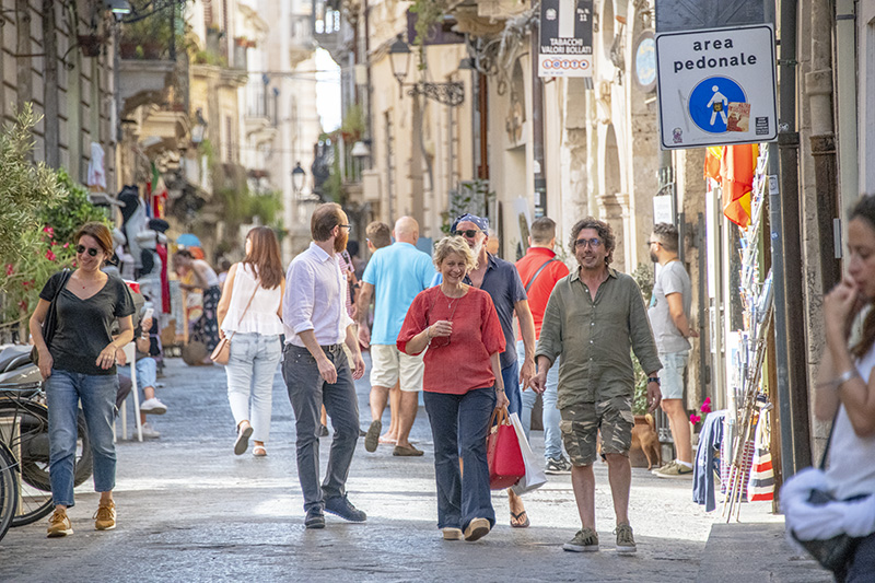 shoppers on a street - tour of sicily