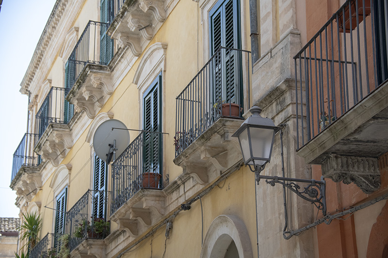 old balconies on a building - cities in Sicily