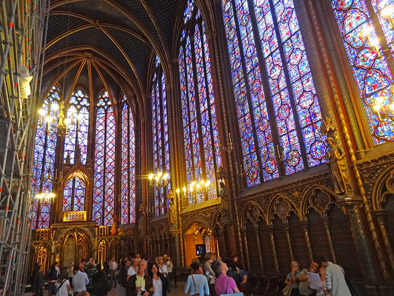 people looking at stained glass windows - walking tour of Paris