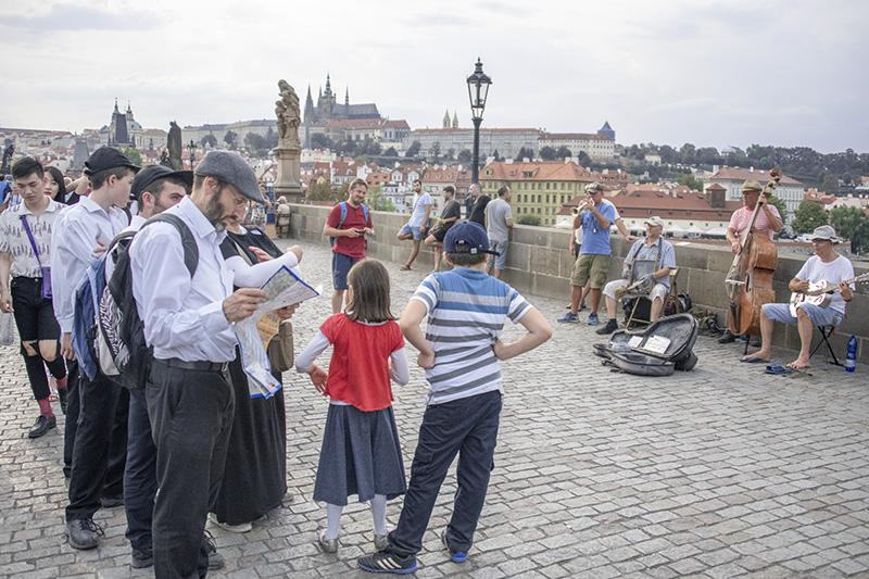 man looking at a map of Prague