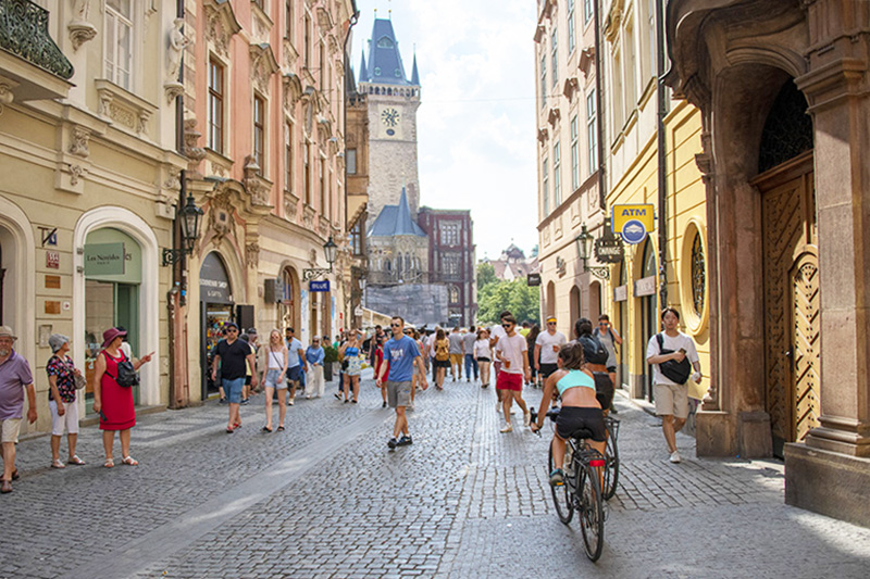 Bicycling through Old Town Prague, one of the most popular places for a walking tour of the city