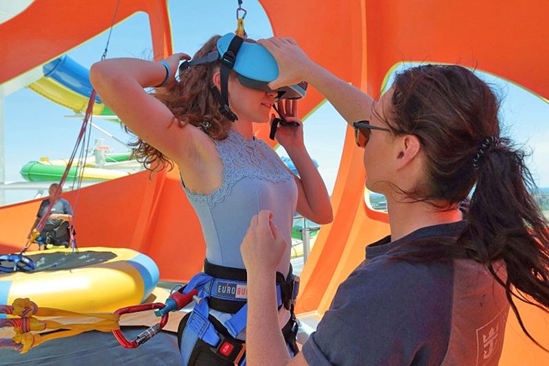 woman puting on a virtual reality mask on a mini-crruise