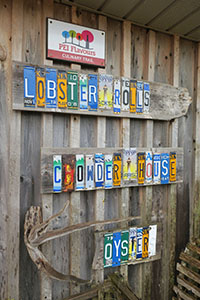 A sign made from old license plates on a wall of a Prince Edward Island restaurant