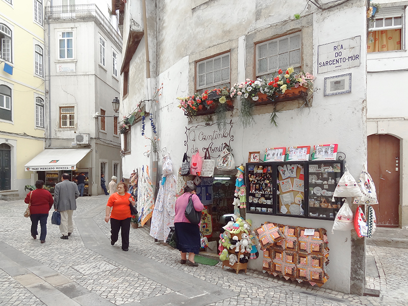 image showing people walking into shops on a day trip from Lisbon