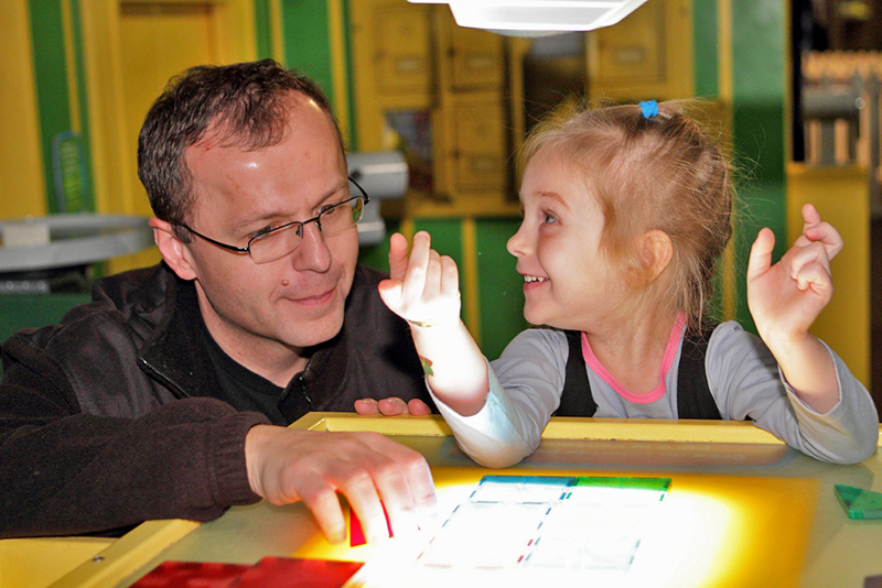 a man playing with a child, one of many Atlanta attractions