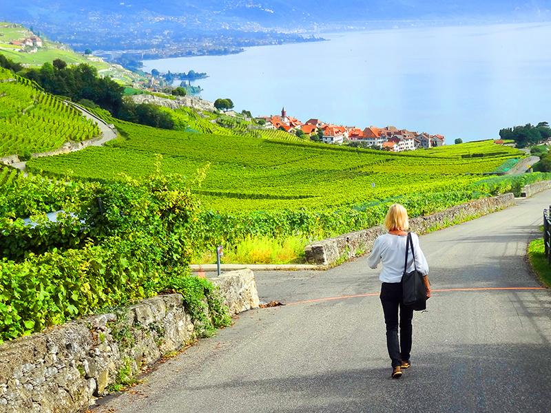 a woman walking through the Lavaux Vineyards