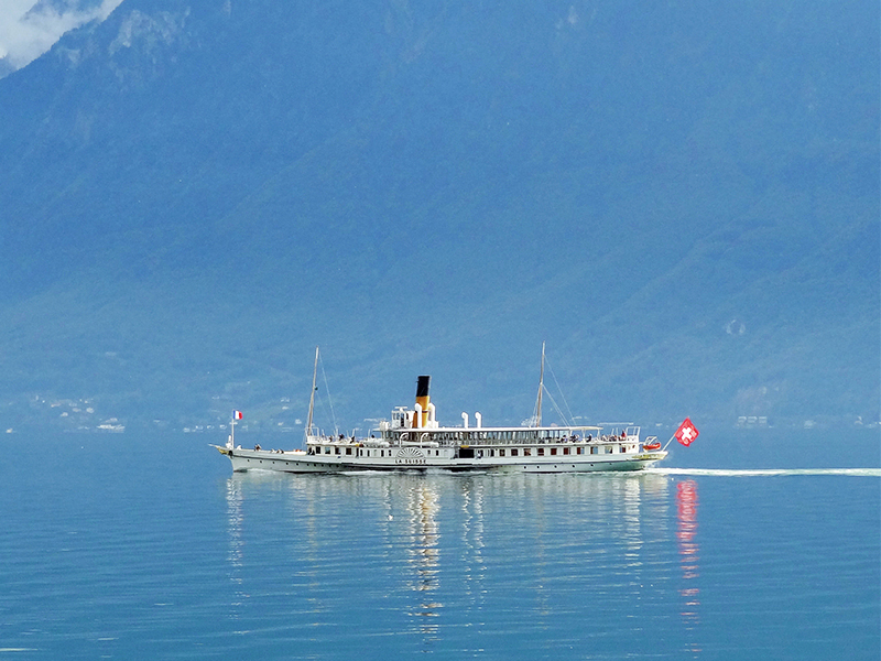 an old lake steamer passing near the Lavaux Vinorama on the Swiss Riviera