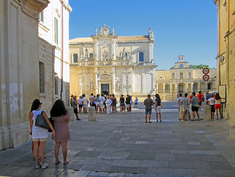 People viewing an old Baraque church in Lecce, Italy