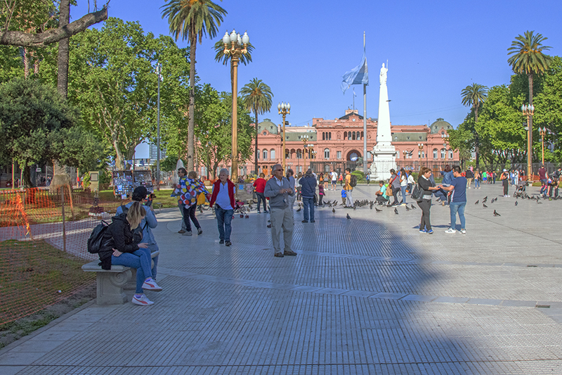 people relaxing in a plaza, one of the things to do in Buenos Aires