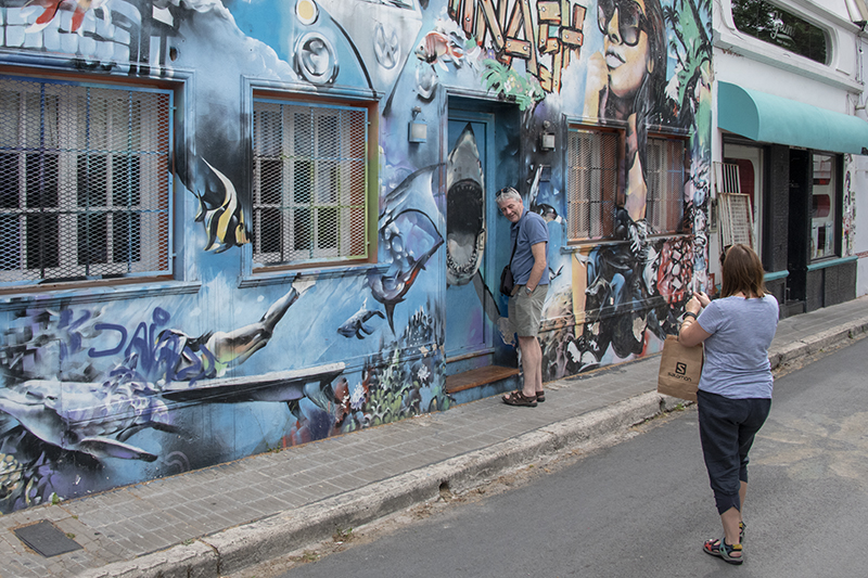 people taking a photo of a painted building in Palermo, Buenos Aires
