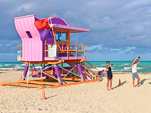 a colorful lifeguard stand on the beach, one of the attractions in Miami