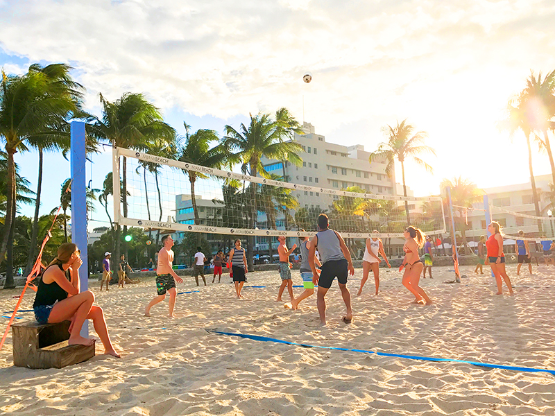people playing volleyball on the beach in South Beach