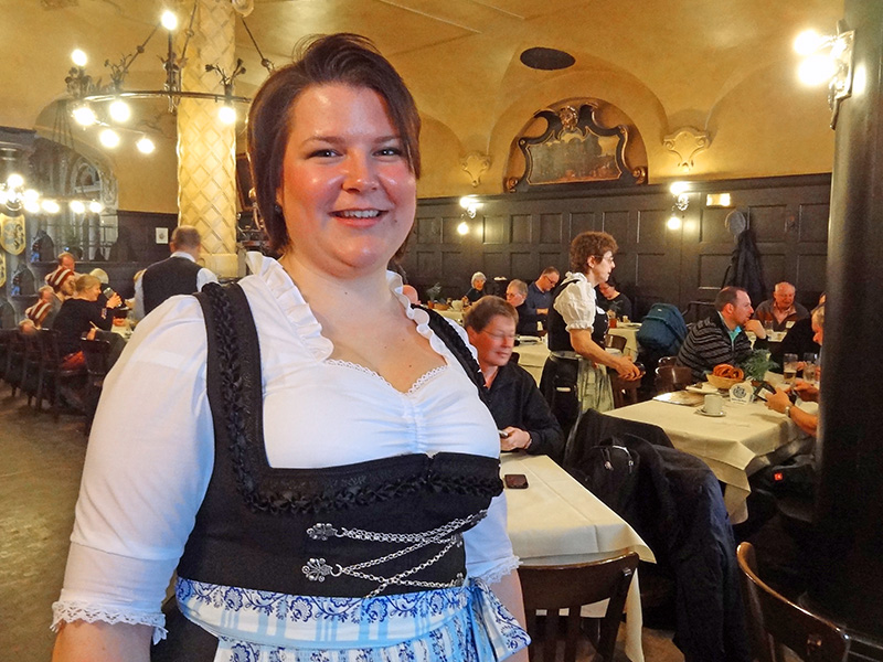 A waitress in a dirndl at a Munich beerhall, one of the places to visit during two days in Munich