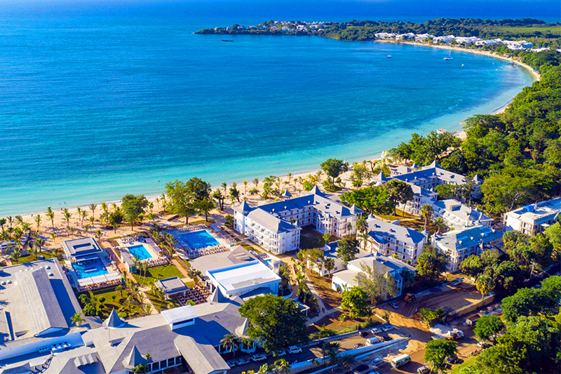 an aerial view of Negril, Jamaica and the Riu Palace Tropical Bay