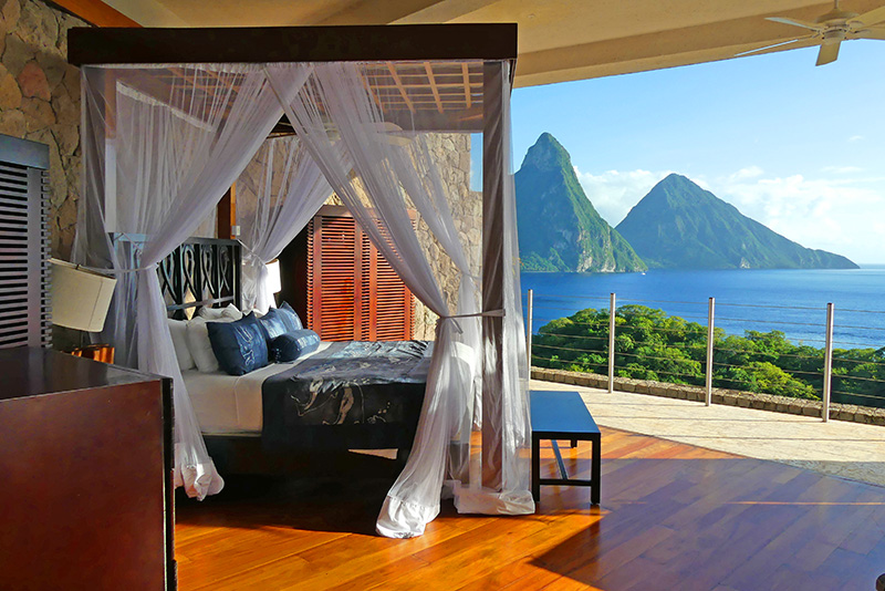 a hotel room open to the sea and mountains