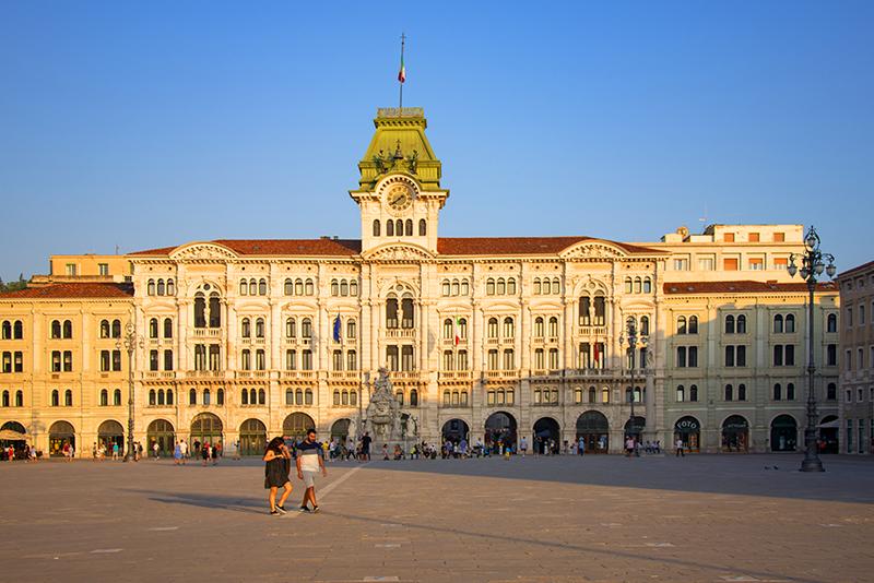 people walking across a large plaza in Trieste