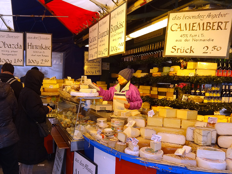 A cheesemonger during a visit to the Viktualienmarkt, one of the things to do in Munich