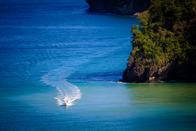 a speeding boat returning to it St. Lucia accommodation