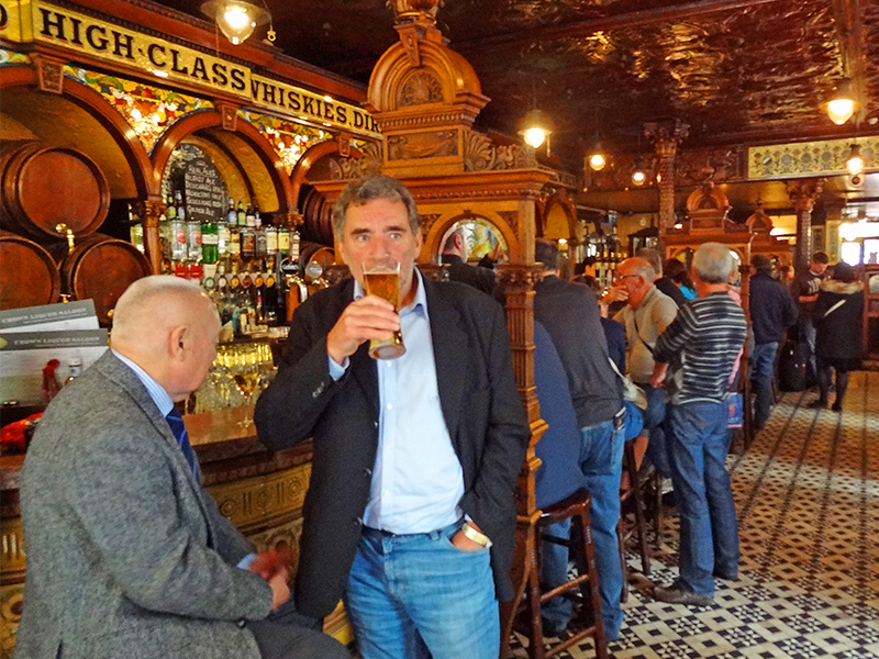 men at a bar in a the Crown Liquor Saloon