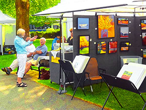 people at an art fair in Bar Harbor, one of the popular towns on Maine Route 1
