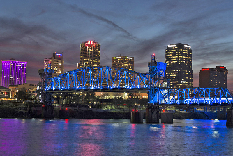 a blue bridge downtown, one of the places to visit in Little Rock