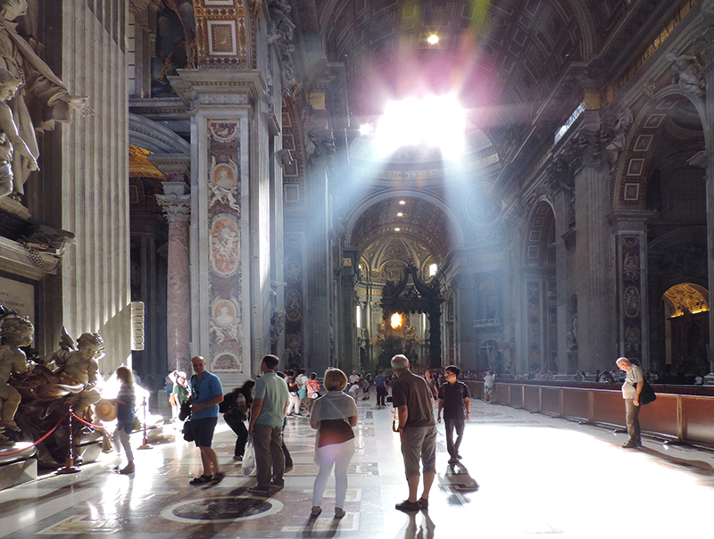 people in St. peter's, a must -see place in Rome