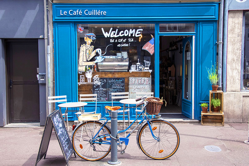 a bicycle in front of a cafe