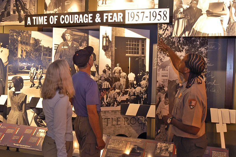 visitors looking at an exhibit at Central High School, one of the things to do in Little Rock