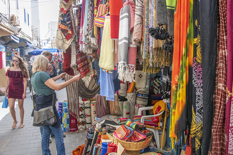 a woman shopping in Essaouira's medina, a good place to visit in Morocco