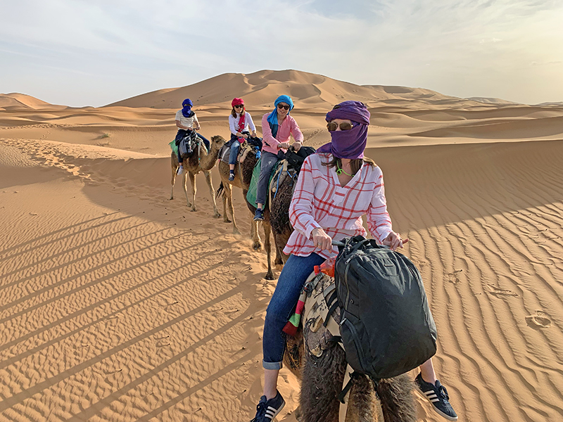 People camel trekking on the Sahara - a fun thing to do in Morocco
