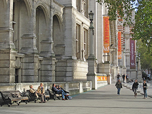 people sitting outside an ornate old building