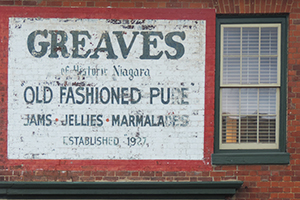 a sign for jams on a brisk wall in NOTL