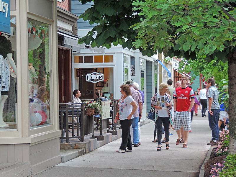 people strolling along Queen Street