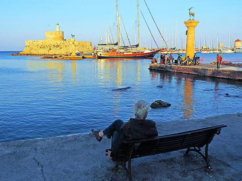 Relaxing by the harbor in Rhodes town, one of the things to do in Rhodes