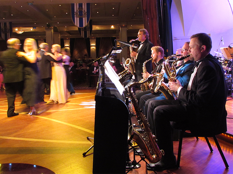 a big band orchestra with people dancing
