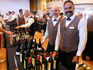 people at a tasting on a wine cruise