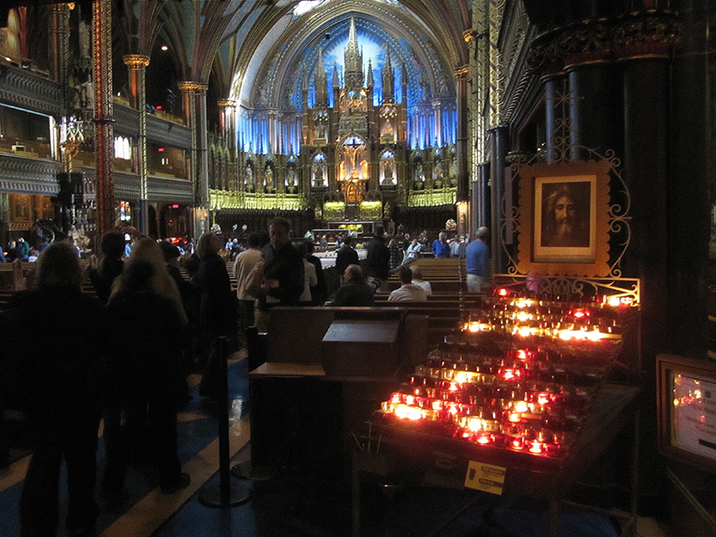 people at mass in a basilica, seen on a weekend in Montreal